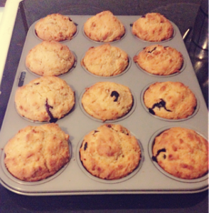 Tray of freshly baked Easy banana, blueberry, coconut muffins